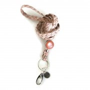 sleutelkoord gevlochten roze cabochon